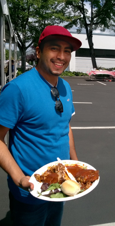 Employee with food at bbq